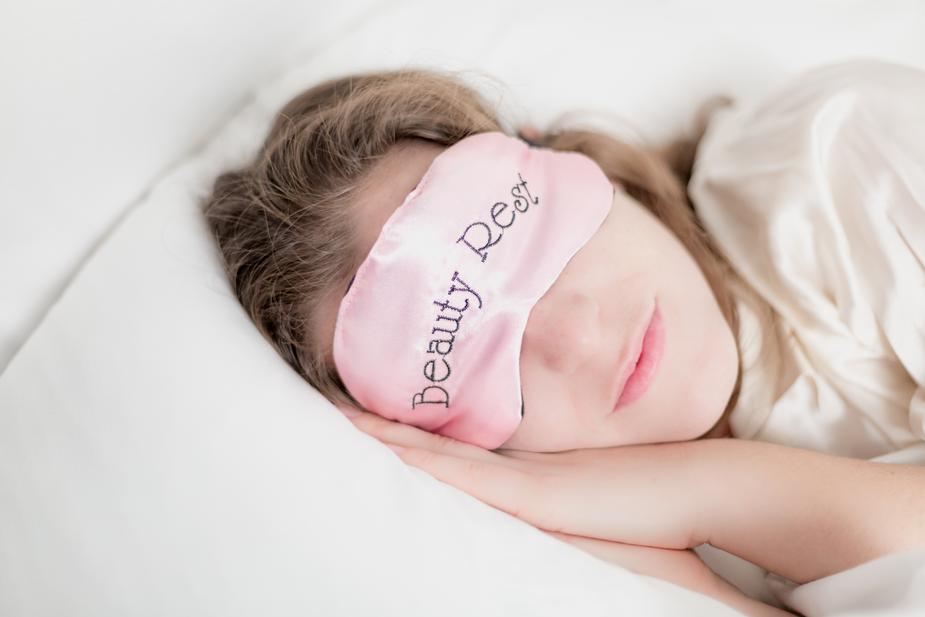 Woman sleeping with blindfold