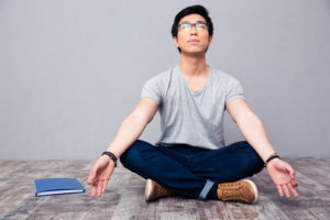 Young asian man meditating