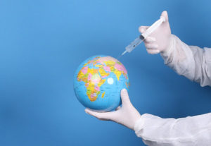 Image of doctor holding globe with injection needle